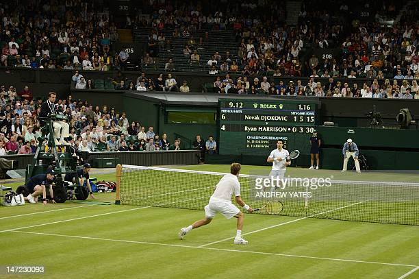 Serbia's Novak Djokovic plays against US player Ryan Harrison during their second round men's singles victory on day three of the 2012 Wimbledon...