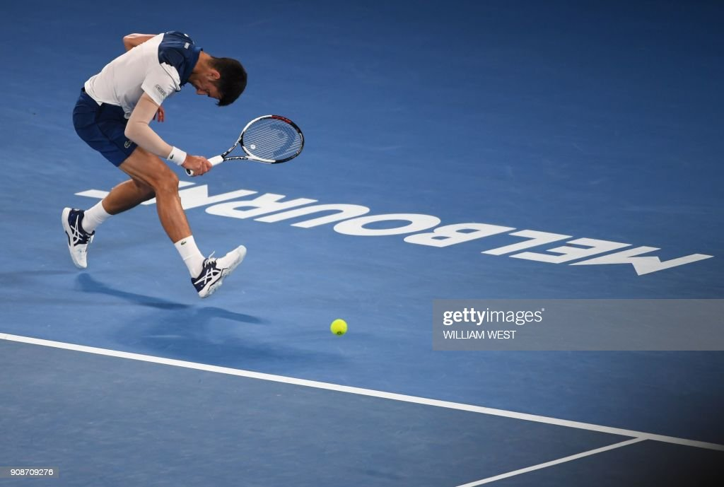 TOPSHOT - Serbia's Novak Djokovic reacts after a point against South Korea's Hyeon Chung during their men's singles fourth round match on day eight of the Australian Open tennis tournament in Melbourne on January 22, 2018. /