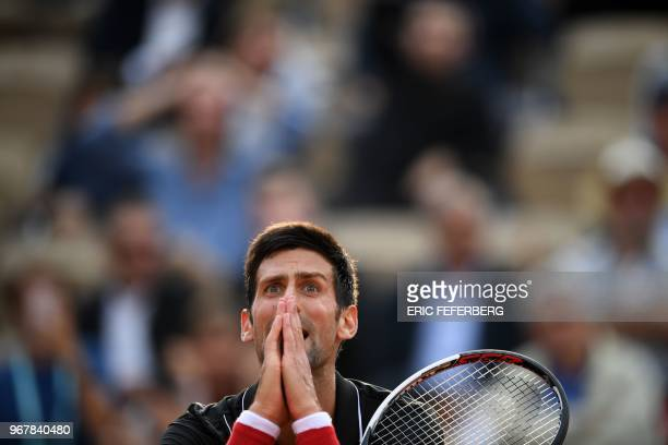 Serbia's Novak Djokovic reacts after a point in the fourth set against Italy's Marco Cecchinato during their men's singles quarterfinal match on day...