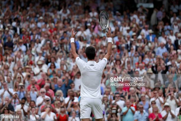 Serbia's Novak Djokovic reacts after beating Spain's Rafael Nadal in their men's singles semifinal match on the twelfth day of the 2018 Wimbledon...