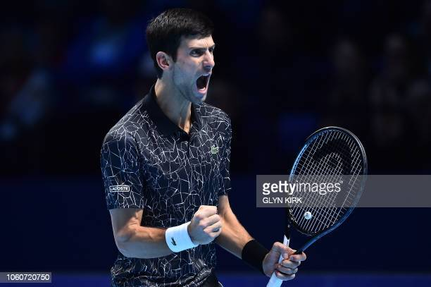 TOPSHOT Serbia's Novak Djokovic reacts after breaking serve to go 43 in the second set against US player John Isner during their men's singles...