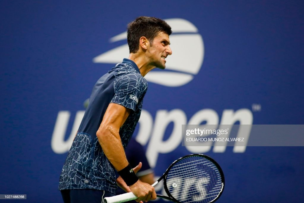 Serbia's Novak Djokovic reacts after losing a point against Australia's John Millman in their Men's Singles Quarter-Finals tennis match at the 2018 US Open at the USTA Billie Jean King National Tennis Center in New York on September 5, 2018.