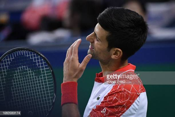 Serbia's Novak Djokovic reacts after losing a point against Germany's Alexander Zverev during their men's singles semifinals match at the Shanghai...