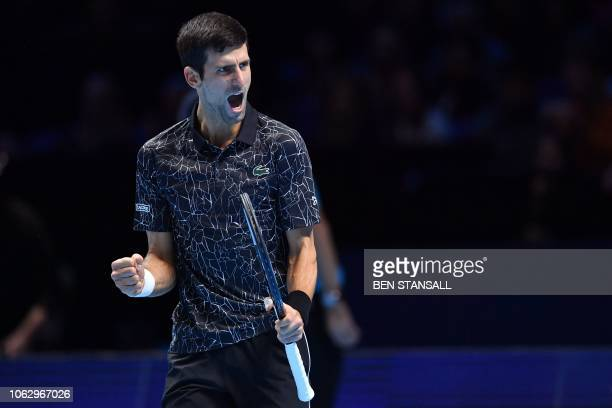 Serbia's Novak Djokovic reacts after winning a game during their men's singles semifinal match against South Africa's Kevin Anderson on day seven of...