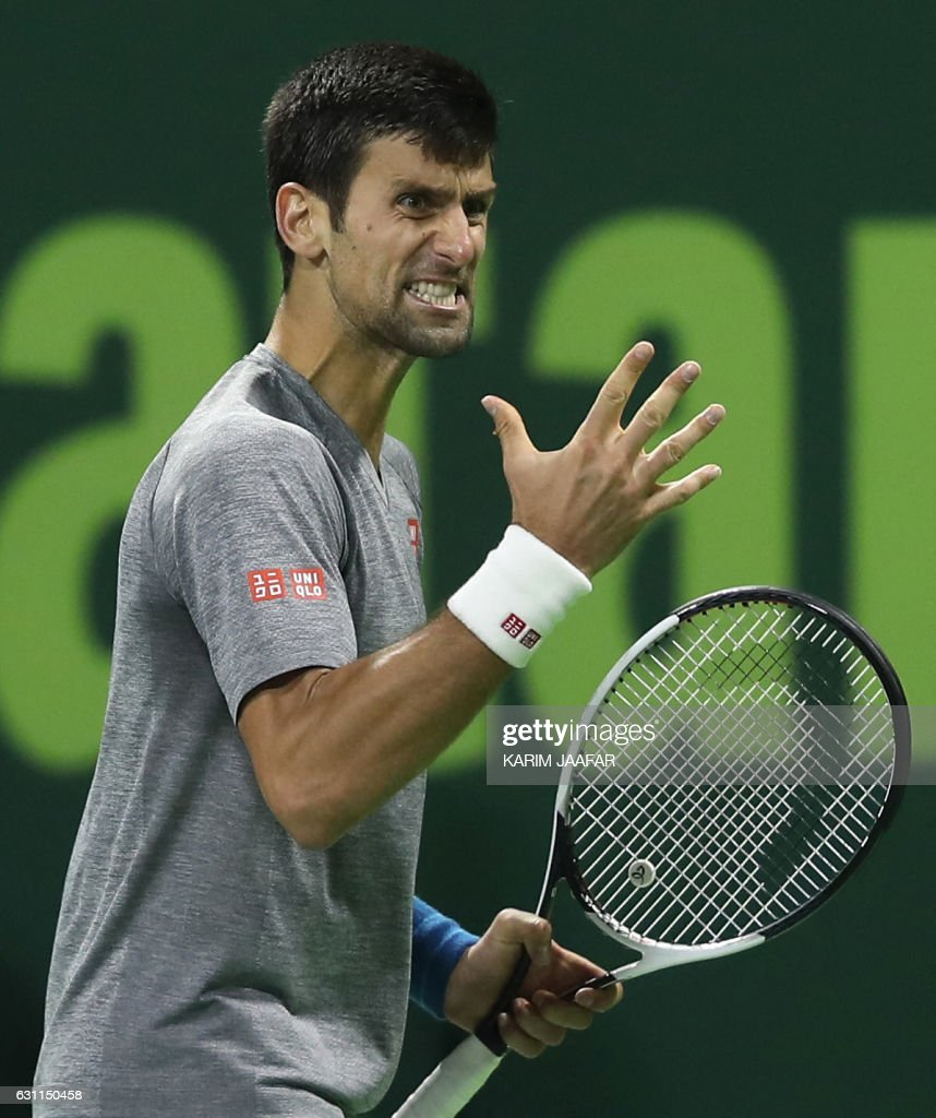 Serbia's Novak Djokovic reacts after winning against Britain's Andy Murray during their final tennis match at the ATP Qatar Open in Doha on January 7, 2017. / AFP / KARIM