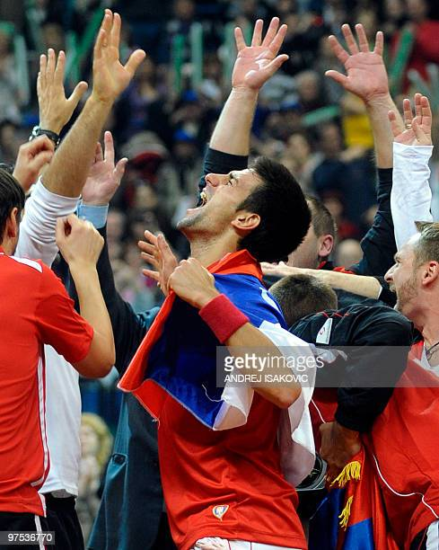 Serbia's Novak Djokovic reacts after winning against John Isner of the US during their Davis Cup World Group first round tennis match on March 7 in...
