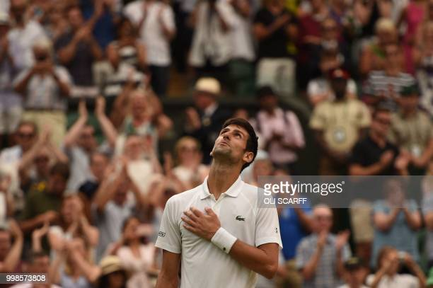 TOPSHOT Serbia's Novak Djokovic reacts after winning against Spain's Rafael Nadal during the continuation of their men's singles semifinal match on...