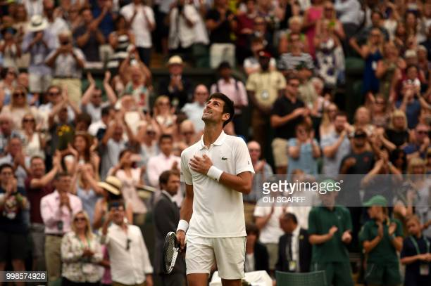 Serbia's Novak Djokovic reacts after winning against Spain's Rafael Nadal during the continuation of their men's singles semifinal match on the...