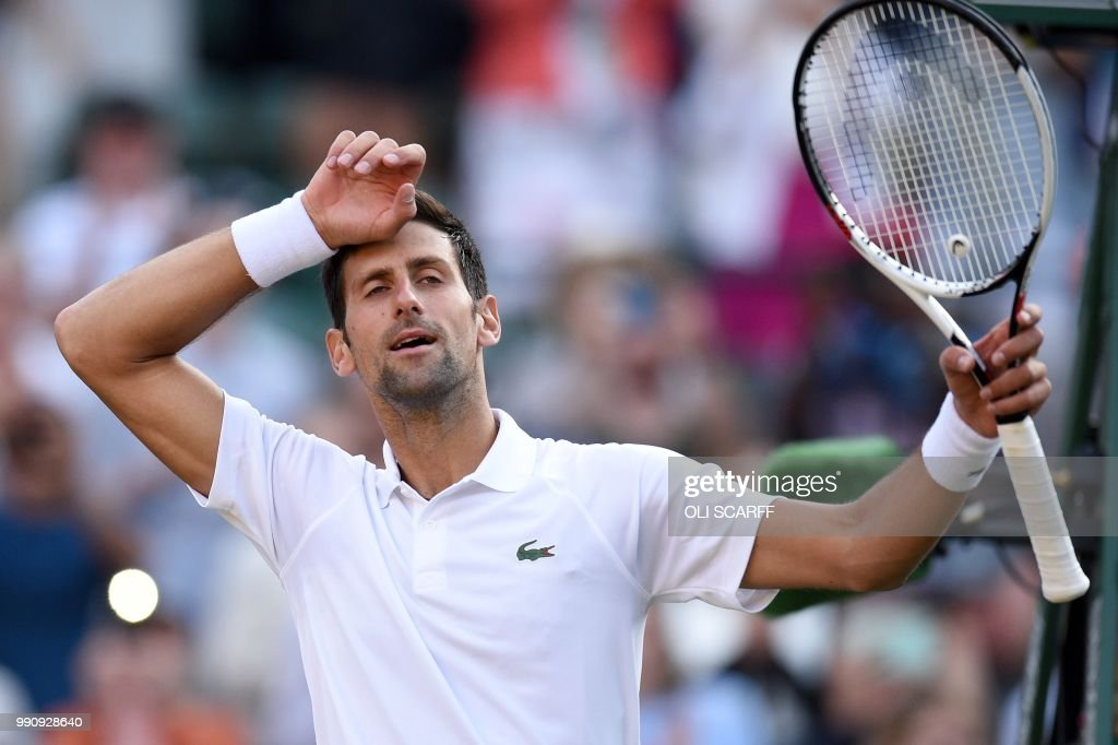 Serbia's Novak Djokovic reacts after winning against US Player Tennys Sandgren during their men's singles first round match on the second day of the 2018 Wimbledon Championships at The All England Lawn Tennis Club in Wimbledon, southwest London, on July 3, 2018. - Djokovic won the match 6-3, 6-1, 6-2. (Photo by Oli SCARFF / AFP) / RESTRICTED