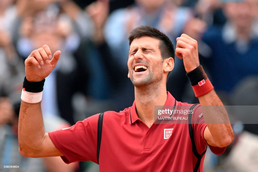 TOPSHOT - Serbia's Novak Djokovic reacts after winning the men's final match against Britain's Andy Murray at the Roland Garros 2016 French Tennis Open in Paris on June 5, 2016. /