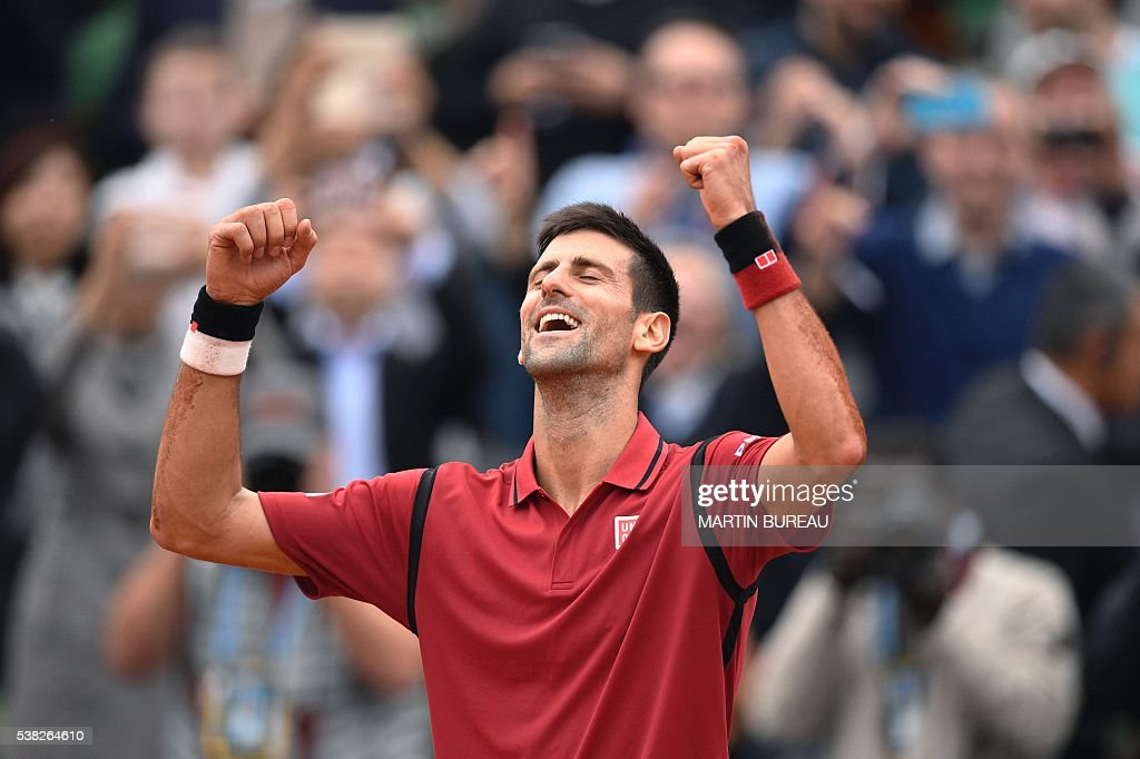 Serbia's Novak Djokovic reacts after winning the men's final match against Britain's Andy Murray at the Roland Garros 2016 French Tennis Open in Paris on June 5, 2016. / AFP / MARTIN