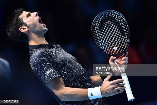 Serbia's Novak Djokovic reacts against US player John Isner during their men's singles roundrobin match on day two of the ATP World Tour Finals...