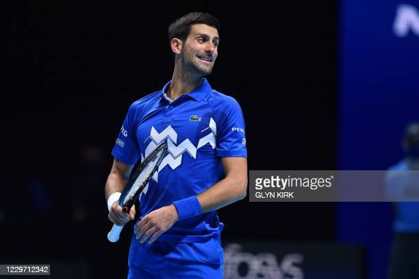 Serbia's Novak Djokovic reacts as he plays against Austria's Dominic Thiem during their men's singles semi-final match on day seven of the ATP World...