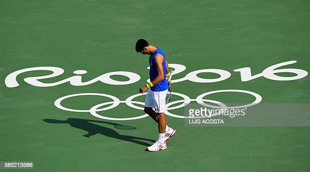 Serbia's Novak Djokovic reacts during a training session at the Olympic Tennis Centre in Rio de Janeiro on August 2 ahead of the Rio 2016 Olympic...