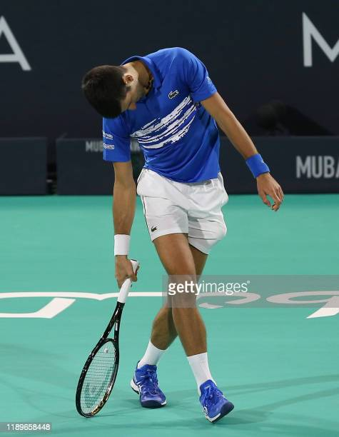 Serbia's Novak Djokovic reacts during his match with Greece's Stefanos Tsitsipas during the semi-finals of the Mubadala World Tennis Championship at...
