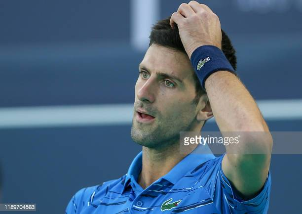Serbia's Novak Djokovic reacts during the Mubadala World Tennis Championship 3rd Place match at Zayed Sports City in Abu Dhabi, on December 21, 2019.