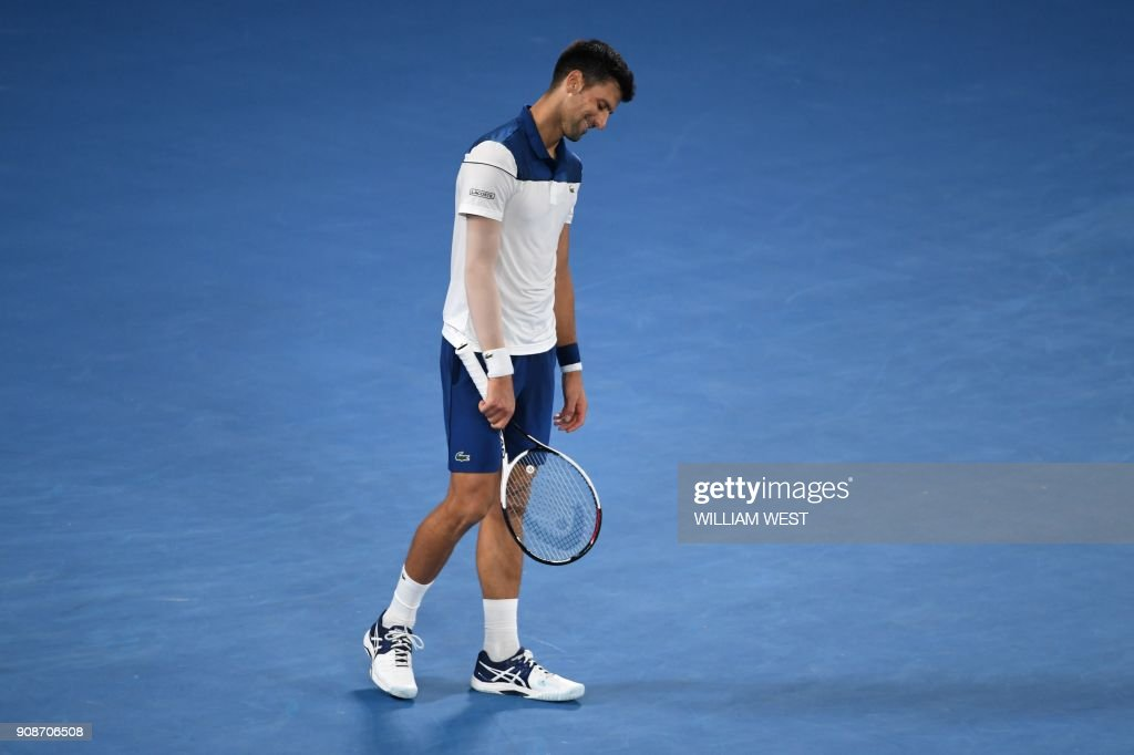 TOPSHOT - Serbia's Novak Djokovic reacts during their men's singles fourth round match against South Korea's Hyeon Chung on day eight of the Australian Open tennis tournament in Melbourne on January 22, 2018. /