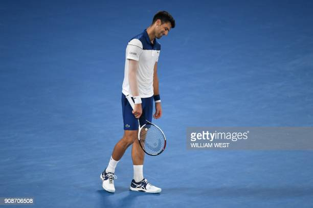 TOPSHOT Serbia's Novak Djokovic reacts during their men's singles fourth round match against South Korea's Hyeon Chung on day eight of the Australian...