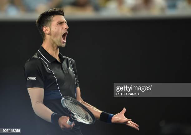 TOPSHOT Serbia's Novak Djokovic reacts during their men's singles third round match against Spain's Albert RamosVinolas on day six of the Australian...