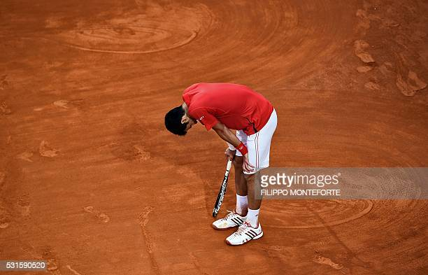 TOPSHOT Serbia's Novak Djokovic rests during the final match of the ATP Tennis Open tournament game against Andy Murray of Great Britain at the Foro...