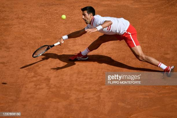 Serbia's Novak Djokovic returns a forehand to Spain's Alejandro Davidovich during their match of the Men's Italian Open at Foro Italico on May 13,...