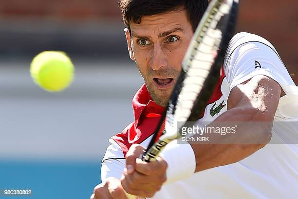 Serbia's Novak Djokovic returns against Bulgaria's Grigor Dimitrov during their men's singles secondround match at the ATP Queen's Club Championships...