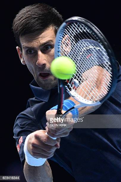 Serbia's Novak Djokovic returns against Canada's Milos Raonic during their round robin stage men's singles match on day three of the ATP World Tour...