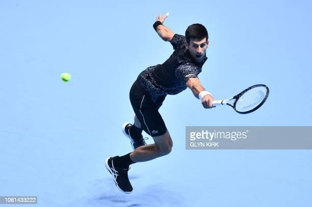 TOPSHOT Serbia's Novak Djokovic returns against Germany's Alexander Zverev during their mens singles roundrobin match on day four of the ATP World...