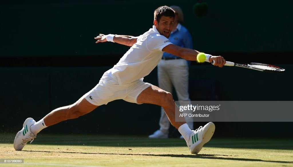 Serbia's Novak Djokovic returns against Latvia's Ernests Gulbis during their men's singles third round match on the sixth day of the 2017 Wimbledon Championships at The All England Lawn Tennis Club in Wimbledon, southwest London, on July 8, 2017. / AFP PHOTO / Oli SCARFF / RESTRICTED