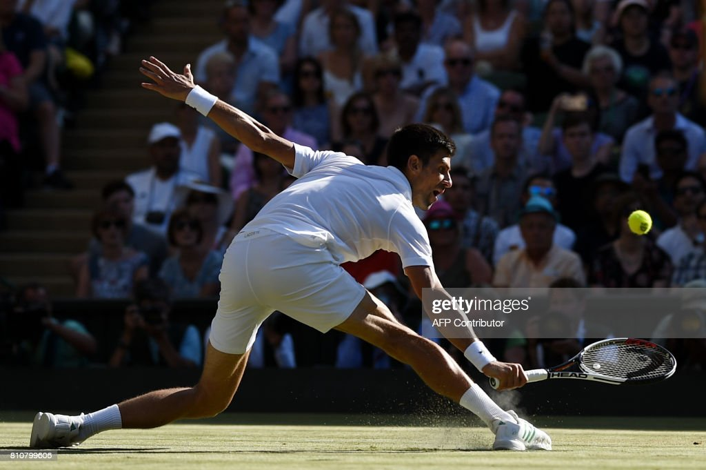 TOPSHOT - Serbia's Novak Djokovic returns against Latvia's Ernests Gulbis during their men's singles third round match on the sixth day of the 2017 Wimbledon Championships at The All England Lawn Tennis Club in Wimbledon, southwest London, on July 8, 2017. / AFP PHOTO / Oli SCARFF / RESTRICTED