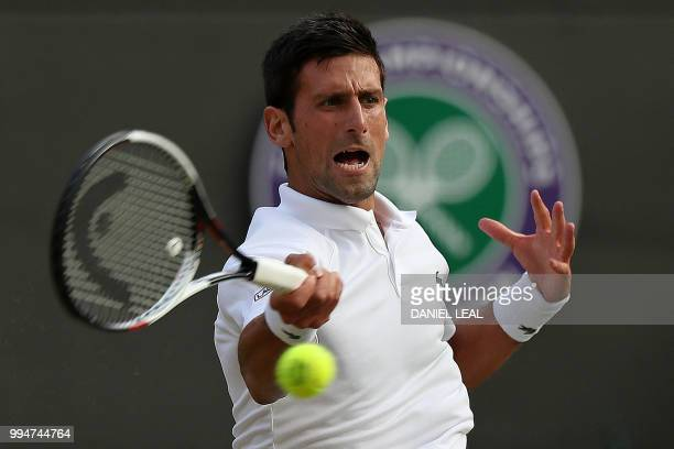Serbia's Novak Djokovic returns against Russia's Karen Khachanov during their men's singles fourth round match on the seventh day of the 2018...