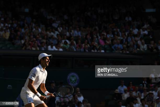 Serbia's Novak Djokovic returns against US player Denis Kudla during their men's singles second round match on the third day of the 2019 Wimbledon...