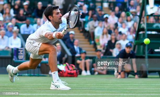 TOPSHOT Serbia's Novak Djokovic returns against US player Denis Kudla during their men's singles second round match on the third day of the 2019...