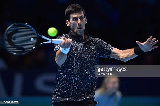 Serbia's Novak Djokovic returns against US player John Isner during their men's singles roundrobin match on day two of the ATP World Tour Finals...