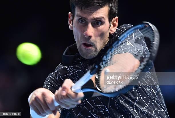 TOPSHOT Serbia's Novak Djokovic returns against US player John Isner during their men's singles roundrobin match on day two of the ATP World Tour...
