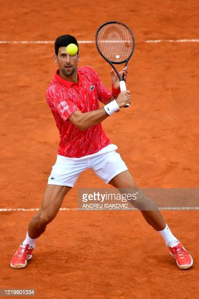 Serbia's Novak Djokovic returns the ball during a tennis doubles match with Jelena Jankovic against Serbia's Nenad Zimonjic and Olga Danilovic during...