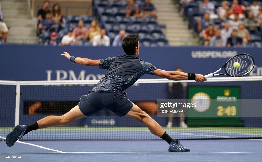 Serbia's Novak Djokovic returns the ball to Australia's John Millman during their Men's Singles Quarter-Finals match at the 2018 US Open at the USTA Billie Jean King National Tennis Center in New York on September 5, 2018.