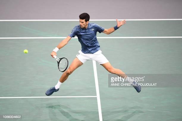 Serbia's Novak Djokovic returns the ball to Bosnia-Herzegovina's Damir Dzumhur during their men's singles third round tennis match on day four of the...