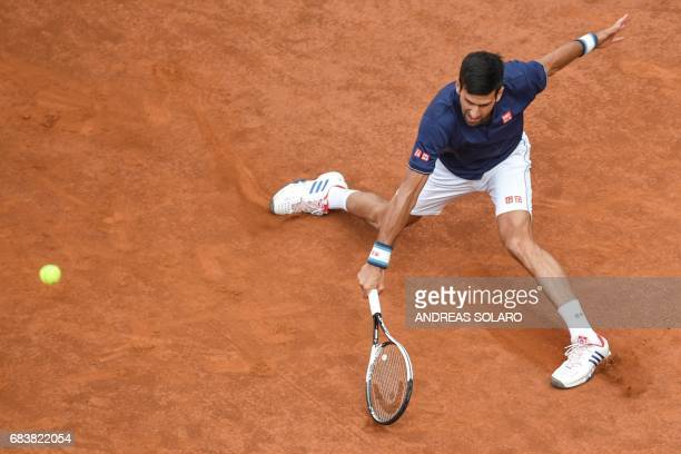 Serbia's Novak Djokovic returns the ball to Britain's Aljaz Bedene during their tennis match at the ATP Tennis Open tournament on May 16 2017 at the...