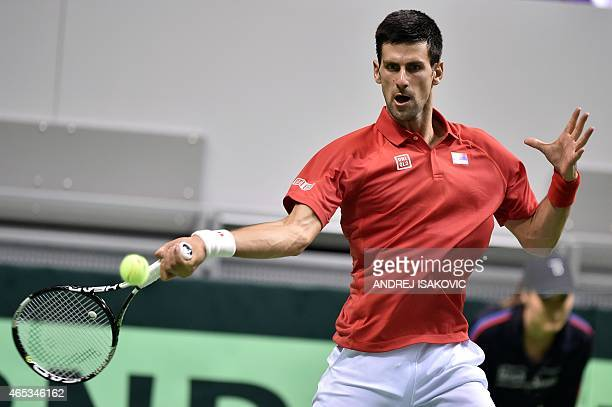 Serbia's Novak Djokovic returns the ball to Croatia's Mate Delic during their Davis Cup World Group first round one single tennis match in the...