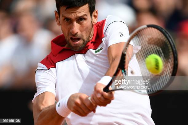 TOPSHOT Serbia's Novak Djokovic returns the ball to Georgia's Nikoloz Basilashvili during Rome's ATP Tennis Open tournament at the Foro Italico on...