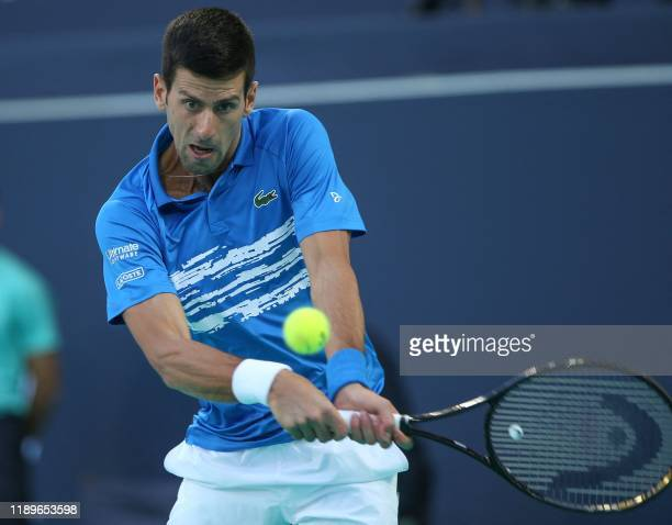 Serbia's Novak Djokovic returns the ball to Greece's Stefanos Tsitsipas during the Mubadala World Tennis Championship at Zayed Sports City in Abu...