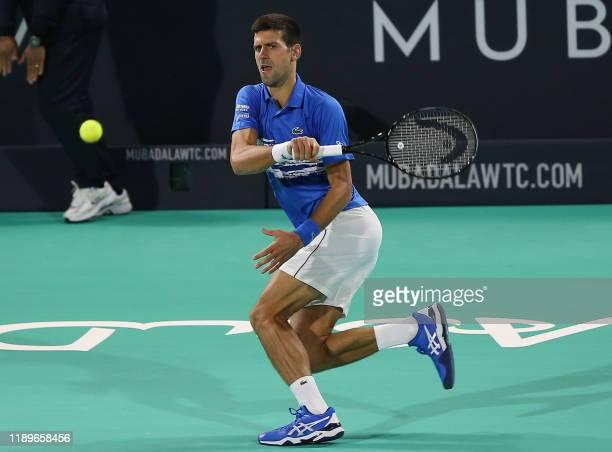 Serbia's Novak Djokovic returns the ball to Greece's Stefanos Tsitsipas during the semi-finals of the Mubadala World Tennis Championship at Zayed...