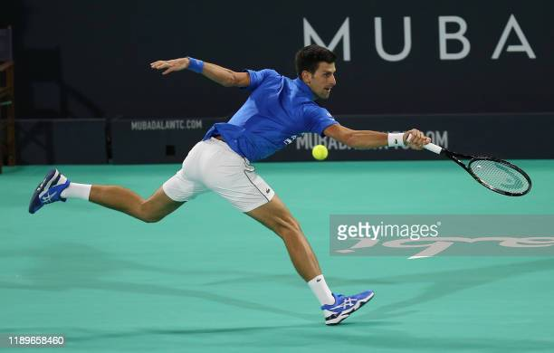 Serbia's Novak Djokovic returns the ball to Greece's Stefanos Tsitsipas during their semifinal match of the Mubadala World Tennis Championship at...