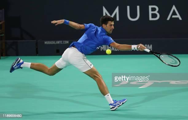 Serbia's Novak Djokovic returns the ball to Greece's Stefanos Tsitsipas during their semi-final match of the Mubadala World Tennis Championship, at...