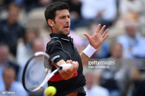 Serbia's Novak Djokovic returns the ball to Italy's Marco Cecchinato during their men's singles quarterfinal match on day ten of The Roland Garros...