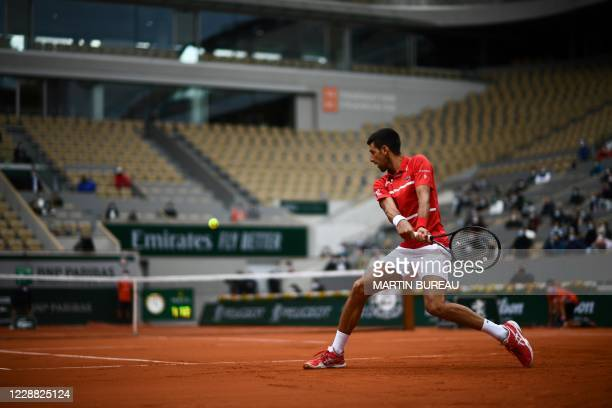 Serbia's Novak Djokovic returns the ball to Lithuania's Ricardas Berankis during their men's singles second round tennis match at the Philippe...