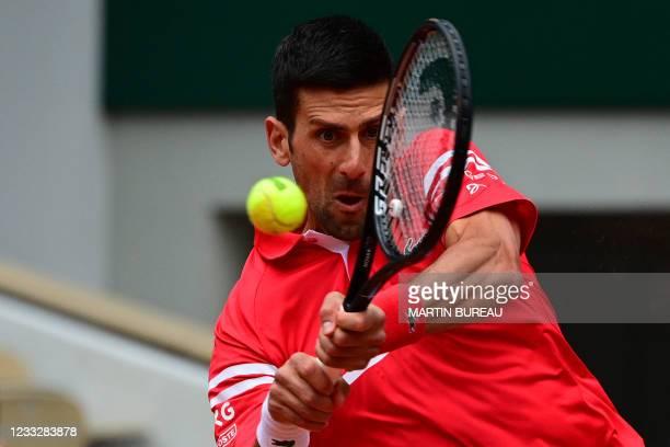 Serbia's Novak Djokovic returns the ball to Lithuania's Ricardas Berankis during their men's singles third round tennis match on Day 7 of The Roland...