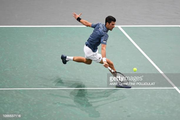 Serbia's Novak Djokovic returns the ball to Portugal's Joao Sousa during their men's singles second round match on day two of the ATP World Tour...