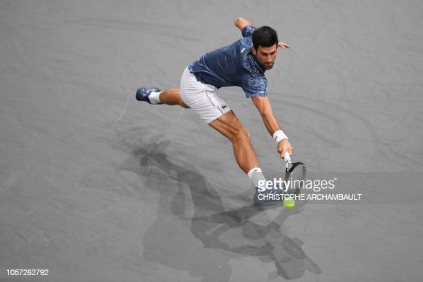TOPSHOT Serbia's Novak Djokovic returns the ball to Russia's Karen Khachanov during their men's singles final tennis match on day seven of the ATP...